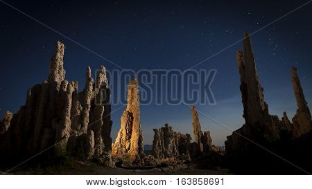 Mono Lake Tufa Formations In Moonlight. Shallow Depth Of Field With Focus On The Light Painted Rock
