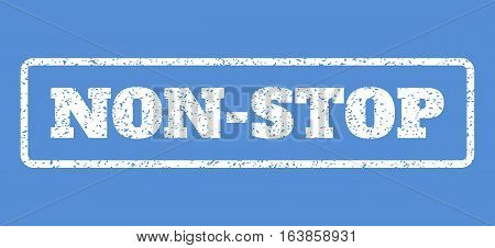 White rubber seal stamp with Non-Stop text. Vector message inside rounded rectangular banner. Grunge design and scratched texture for watermark labels. Horisontal sign on a blue background.