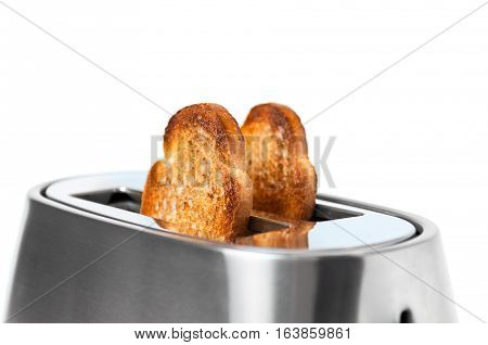 fresh toasted toast and a toaster, healthy breakfast, shallow depth of field, close up