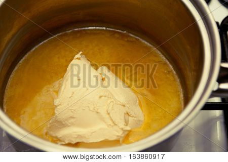 Melting Butter In A Pan On The Hob, Ready To Cook Flapjack