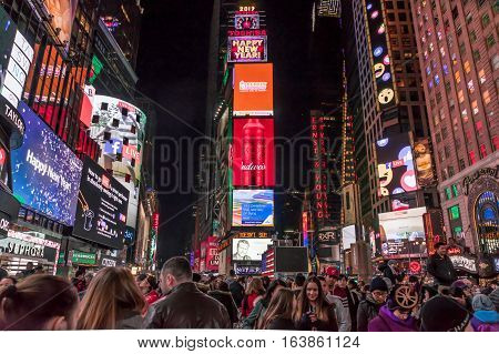 New York NY USA- Jan 1 2017. Time Square by night with crowds of tourists and LED signs lighting up the place.