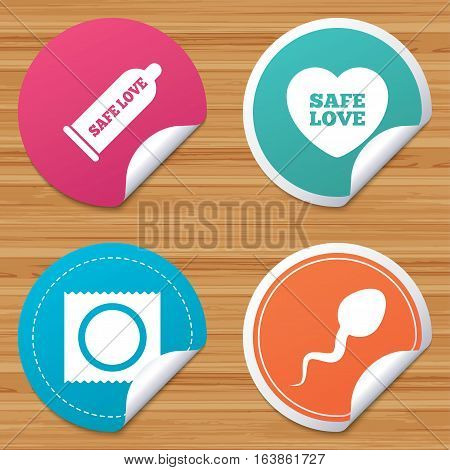 Round stickers or website banners. Safe sex love icons. Condom and package symbol. Sperm sign. Fertilization or insemination. Circle badges with bended corner. Vector
