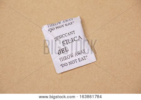 silica gel pack on wooden table background