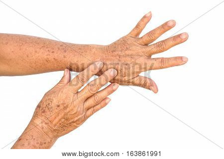 Old Asian female hands full of freckles / Aging concept