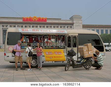 Business traveling from Beijing. Beijing, China - June 08, 2016 Customers after buying the car with food and drinks at the Tiananmen Square in Beijing.