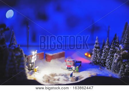 scene of life on a construction site in the polar night around the winter forest in miniature.