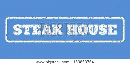 White rubber seal stamp with Steak House text. Vector tag inside rounded rectangular banner. Grunge design and scratched texture for watermark labels. Horisontal sign on a blue background.
