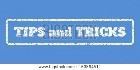 White rubber seal stamp with Tips and Tricks text. Vector caption inside rounded rectangular shape. Grunge design and scratched texture for watermark labels. Horisontal sticker on a blue background.