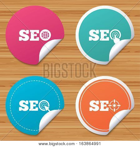 Round stickers or website banners. SEO icons. Search Engine Optimization symbols. World globe and mouse or hand cursor pointer signs. Circle badges with bended corner. Vector