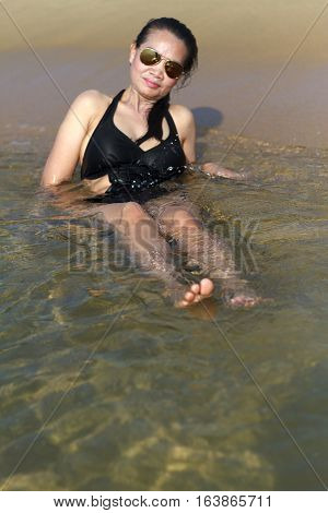 Lady relax body swimsuit in Ban Krut Beach at Prachuap Khirikhun Province Thailand