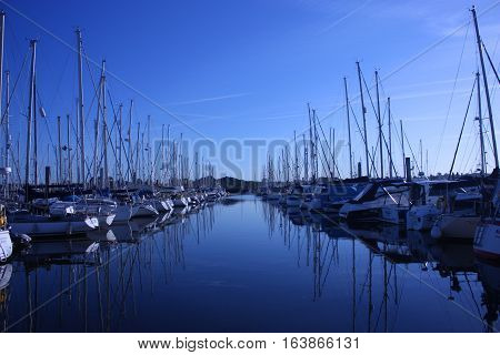 Sailing And Power Boats Moored In Lymington Marina