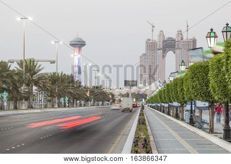 ABU DHABI UAE - NOV 26 2016: Corniche Road in the city of Abu Dhabi at dusk. United Arab Emirates Middle East