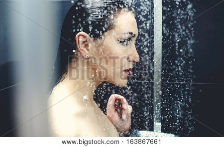 Beautiful sexy  young woman washing body in a shower