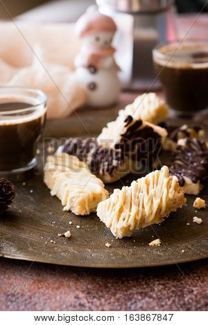 Homemade Christmas shortbread cookies with chocolate on vintage metal plate. Christmas treats.