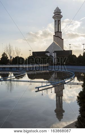 Tehran International Permanent Fairground Reflection of Minaret in Waters Pool Vertical Shot.