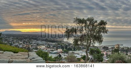 Panoramic view of cirrocumulus clouds over city of Ventura at dawn.