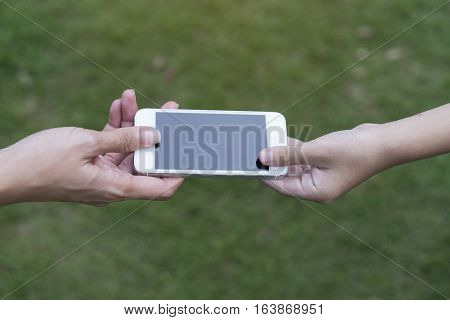 A mother giving her child a mobile phone
