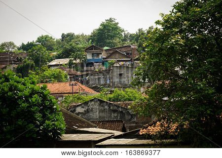 Slums on a mountain with green view photo taken in Semarang Indonesia java
