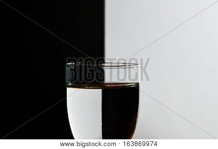 glass water with refraction light in black and white background
