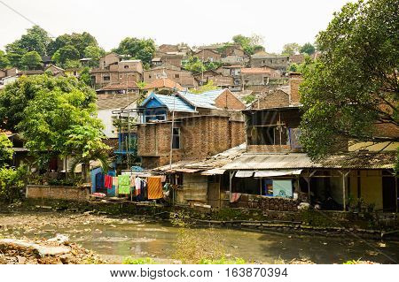Slums near dirty river photo taken in Semarang Indonesia java
