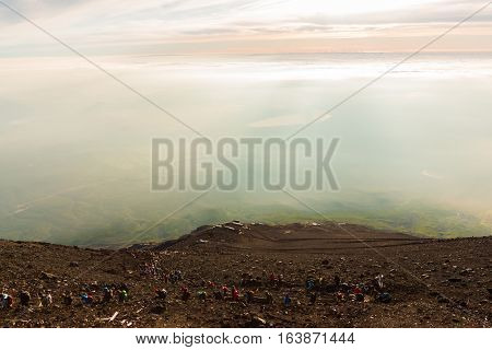 Crowds Of Climbers At The Summit. People Climb The Fuji Mountain.
