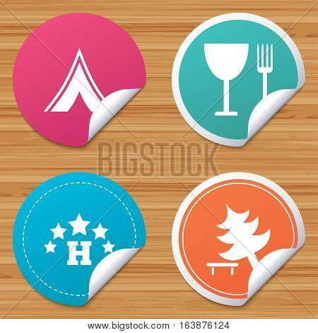 Round stickers or website banners. Food, hotel, camping tent and tree icons. Wineglass and fork. Break down tree. Road signs. Circle badges with bended corner. Vector