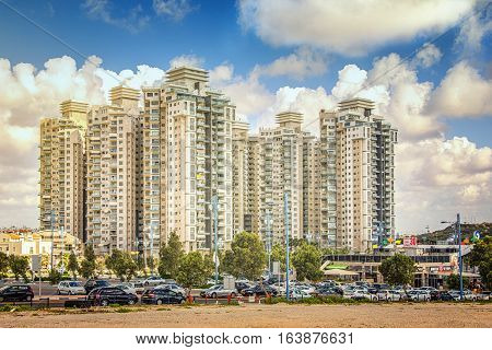 Rishon LeZion, Israel-May 27, 2016: The Sea Gate residential complex of contemporary style buildings. It contains eight 20-story buildings with prestigious apartments and penthouses. Wide shot on perfect cloudy blue sky background
