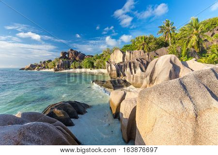 Beautifully shaped granite boulders in illuminated by summer sun on picture perfect tropical Anse Source d'Argent beach, La Digue island, Seychelles.