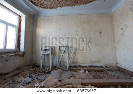 Abandoned old building - reconstruction in haunted house - old window frames, wide angle