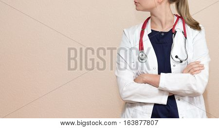 Real female doctor with the red stethoscope in medical uniform