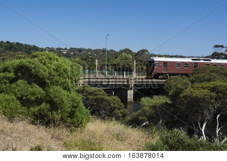Diesel Train on the bridge crossing the Hindmarsh river near the mouth at Victor Harbor Fleurieu Peninsula South Australia.