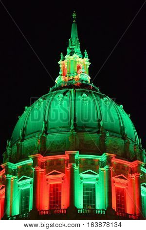 City Hall Dome decorated in Christmas color lighting taken at night in San Francisco, CA