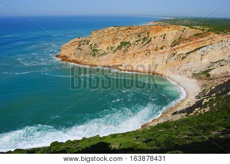 Praia dos Lagosteiros beach near Lisbon in Portugal.