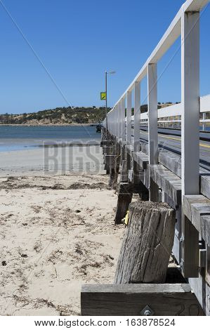 Partial view down the side of the Victor Harbor jetty looking out to Granite Island Fleurieu Peninsula South Australia. Portrait orientation.
