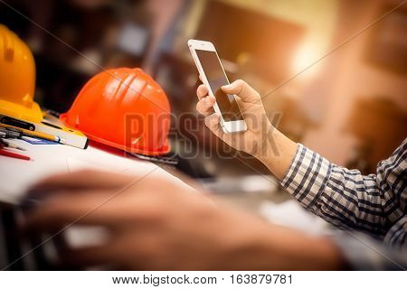 Photography Of Vintage Picture Style Engineering Working At Construction Office Desk And Holding Mob