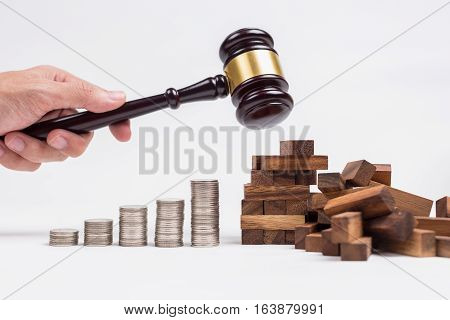 A Man Hand Using Wood Hammer Destroy Wood Toy Building Next To Row Of Coins, Cost Of Destroy Buildin