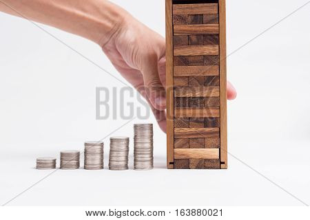 A Man Hand Catch On Block Of Wood Toy Building Next To The Row Of Coins, Cost To Protect Your Buildi