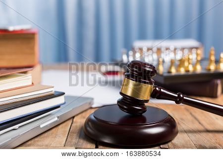 Judge Gravel Close Up Lawyer Desk Workplace, Laptop, Tablet, Law Book, Golden Chess Checkers For Leg