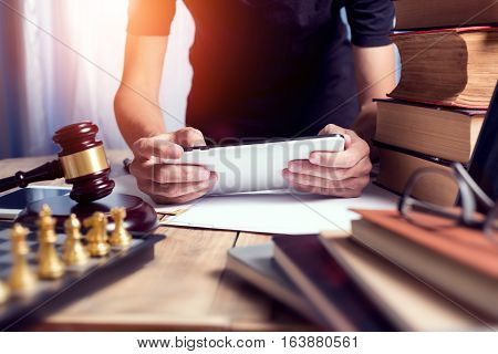 Close Up Young Lawyer Man Using Tablet At His Working Desk In Office Workplace, Hipster View Vintage