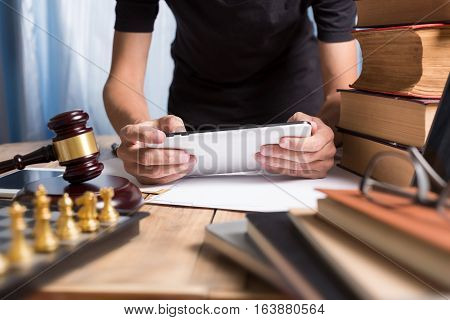 Close Up Young Lawyer Man Using Tablet At His Working Desk In Office Workplace.