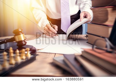 Young Lawyer Business Man Working With Paperwork On His Desk In Office Workplace For Consultant Lawy