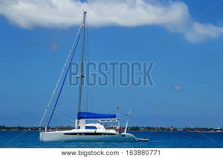 Sailboat anchored near Pangaimotu island in Tonga. Kindom of Tonga is an archipelago comprised of 169 islands