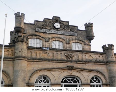 Clock and turrets on Valkenburg Railway Station in Holland