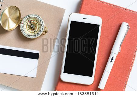Top View From Blank Screen Smartphone On Leather Tablet Case With Office Supply On The Desk