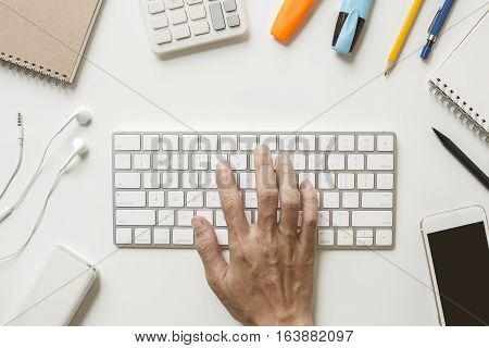 Man Hand Typing White Keyboard On Office Desk With Secretary Office Supplies