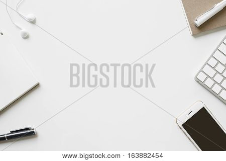 Office Desk Table With Office Supplies And Notepaper. Top View With Copy Space