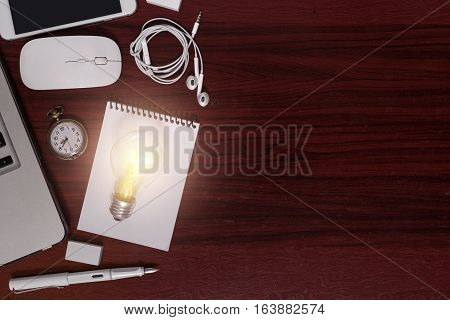 Top view of dark wood business desk antique style with light bulb notepad clock laptop mouse mobile fountain pen flat lay display still life lighting in studio with copy space and electricity of light bulb effect.