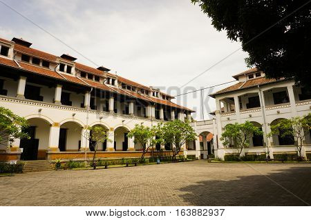 A large pavement field in the middle of Lawang Sewu building photo taken in Semarang Indonesia java