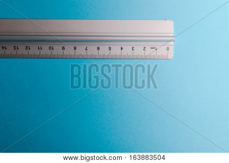 Aluminum Ruler On Blue Background