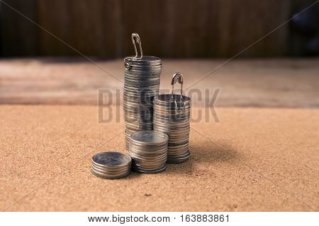 stack of coins with man sitting top viewconcept idea for business growth and finance.